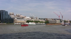 River Thames in London with buildings and cranes in background Stock Footage