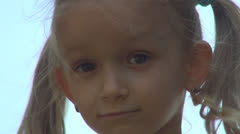 Portrait of Child Nodding, Little Girl Shaking Head Means Yes, Looking in Camera - stock footage