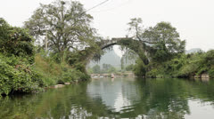 Beautiful Yulong river with ancient stone arch bridge Stock Footage