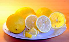 lemons on a plate - stock photo