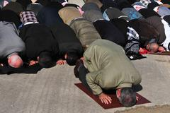 Muslims pray Stock Photos