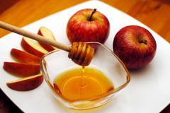 jewish new year - rosh hashanah - apple and honey - stock photo