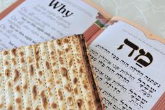 Matza with haggadah for jewish holiday passover Stock Photos
