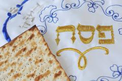 matza and cover for jewish holiday passover - stock photo