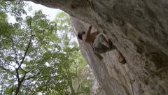 rock climber jumps for handhold - stock footage