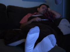 Man Falls Asleep in Front of TV NTSC - stock footage