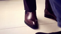 Business man with suit and brown leather shoes - stock footage