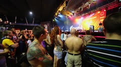 Crowd watch jury on stage of club ARENA. - stock footage