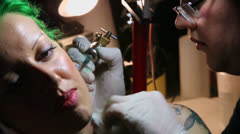 Artist makes tattoo for woman in club ARENA Stock Footage