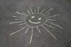 Sun drawing on asphalt Stock Photos