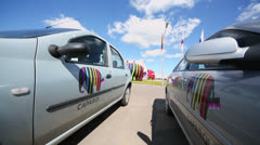 Two cars parked near factory of Caparol in Malino Stock Footage