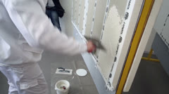 Man demonstrates wall putty during presentation Stock Footage