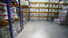 Warehouse with goods on many shelves in Caparol factory Stock Footage