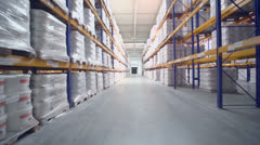 Lot of goods lay on shelves in warehouse of Caparol factory Stock Footage
