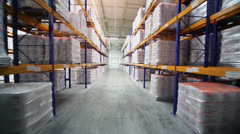 Goods lay on shelves in warehouse of Caparol factory - stock footage