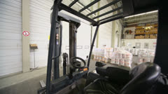 Cabin of loader in warehouse with goods at Caparol factory Stock Footage