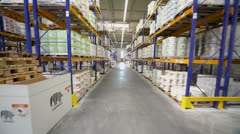 Motion through aisle in warehouse of Caparol factory Stock Footage