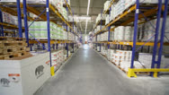 Stock Video Footage of Motion through aisle in warehouse of Caparol factory