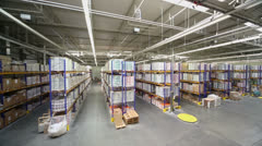 Goods lay on shelves in warehouse at Caparol factory Stock Footage