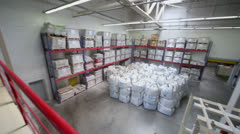 Small warehouse with lot of big white sacks in Caparol factory Stock Footage