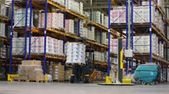 Man rides on loader with goods at Caparol factory Stock Footage