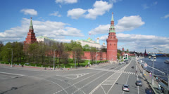 Cars ride near Kremlin by quay of river with ships at day Stock Footage