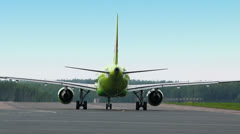 Green aircraft rides by runway among hot air Stock Footage