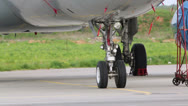 Stock Video Footage of Undercarriage and cabin aircraft on airdrome at sunny day