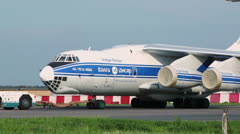 Truck pulls aircraft of Volga-Dnepr airlines at Domodedovo Stock Footage