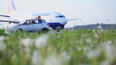 Service car and Aircraft of Transaero airlines rides Stock Footage