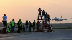 Aircraft of airlines lands to runway with group of spotters Stock Footage