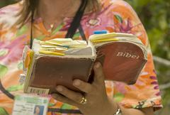 woman reading in bible - stock photo