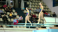 Female double jump during competitions on syncronized diving Stock Footage