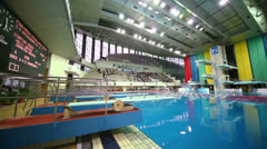 Twofold jump in pool of Sport Complex Olympic during third phase Stock Footage