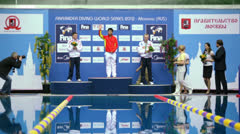 Athletes of Russia and China stand on victory pedestal Stock Footage