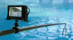 Monitor of camera displays water surface in basin Stock Footage