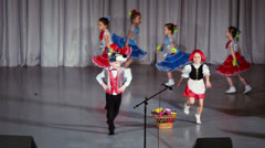 Boy dances with girl during childish Red Riding Hood performance Stock Footage