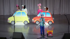 Kids with toy cars scenery perform on stage Stock Footage
