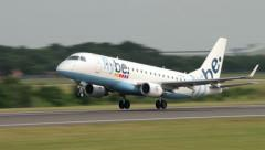 Aircraft takes off from manchester airport, Flybe embraer - stock footage