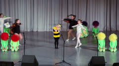 Girls in costumes of bee and of flowers perform on stage Stock Footage