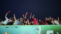 Russian supporters jumps and yell on tribune in Fanzone Stock Footage