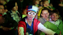 Russian fans with painted faces and funny hat scream in Fanzone Stock Footage