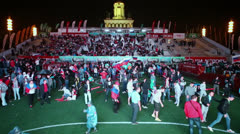 Crowd of football supporters celebrate in Fanzone Stock Footage