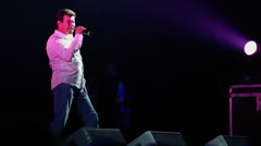 Sergey Chumakov sing during concert of Militia wave radio Stock Footage