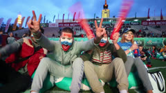 Few young Russian fans scream with flags painted on faces Stock Footage