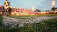 Corner of grass field near tribune for football supporters Stock Footage