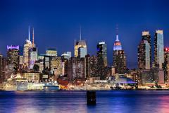 the new york city uptown skyline in the night - stock photo
