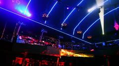 People on second level of night club with light equipment Stock Footage