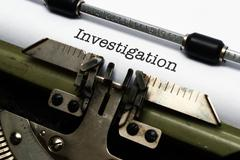 Investigation text on typewriter Stock Photos
