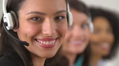 Mexican customer service representative with two co workers in background - stock footage